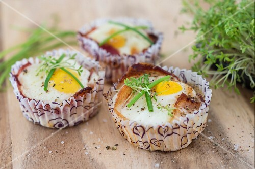 Baked eggs with bacon in paper cases