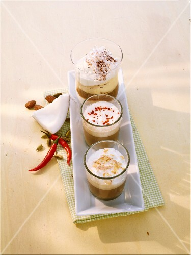 Cafe latte with chilli and cardamom, almond espresso, and coffee with coconut cream and vanilla ice cream
