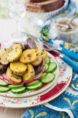 Warm potato salad with cucumber, radishes and a mustard dressing