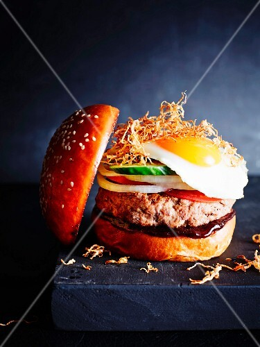 A classic burger with a fried egg, close-up