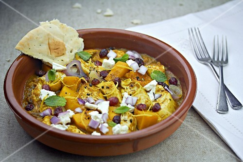 Chicken with pumpkin, feta cheese and unleavened bread (Morocco)