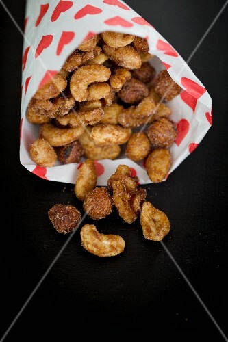 Roasted nuts in a paper bag printed with hearts