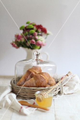 Fresh croissants and honey