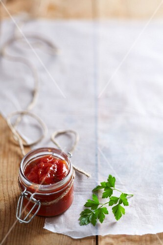 Tomato relish in a flip-top jar on a piece of paper