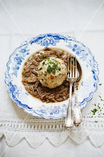 Saure Lunge (Bavarian ragout made with veal lungs) served with a bread dumpling