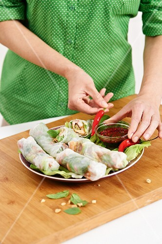 Stuffed rice paper rolls served with a chilli dip
