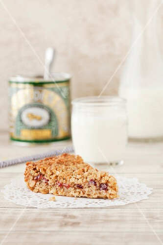 A peanut butter and jam flapjack with golden syrup