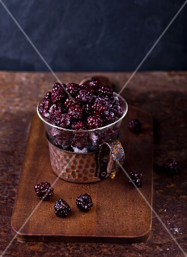 Blackberries in a glass cup