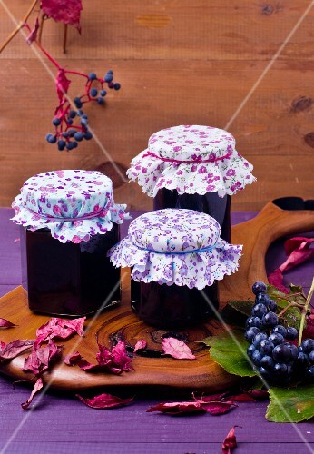 Jars of grape jelly with autumnal leaves