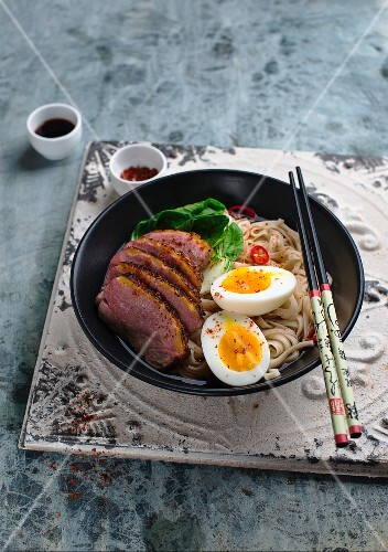 Noodles with bok choy, duck and a hard-boiled egg
