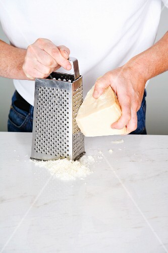 Parmesan cheese being grated