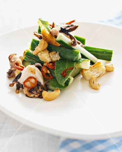 Octopus salad with cucumber, cashew nuts and croutons