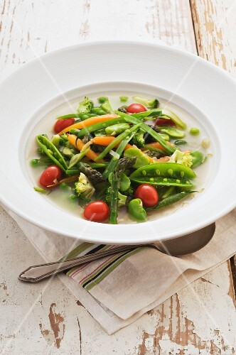 Spring vegetable soup with cherry tomatoes