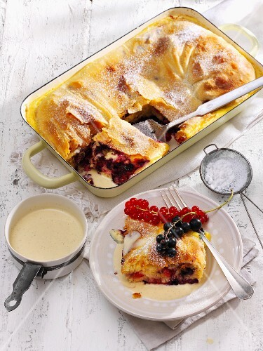 Cream strudel with redcurrants and blackcurrants