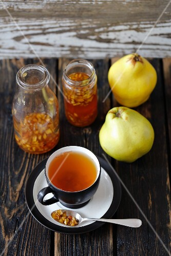 A cup of tea with quince syrup