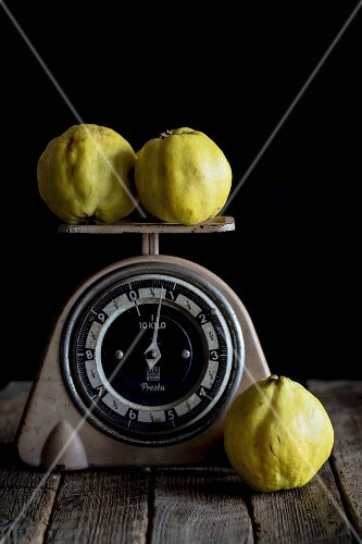 Quinces on a pair of retro scales