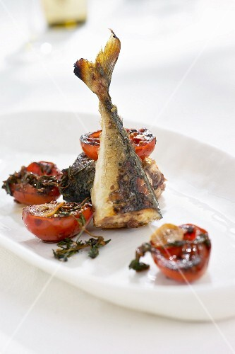 Fried herring with tomatoes