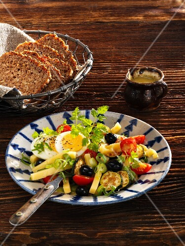 Cheese salad with courgette, tomatoes, eggs and olives