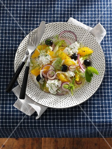 Fennel and orange salad with onions, olives and cottage cheese
