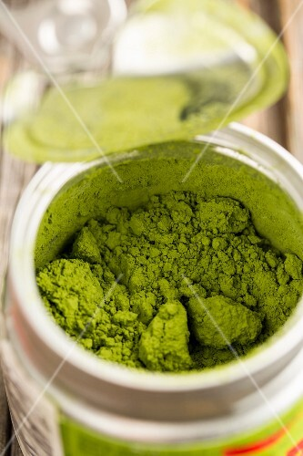 Matcha tea powder in a plastic container (close-up)