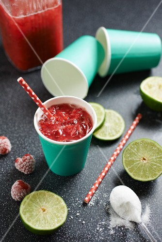A raspberry drink with limes and sugar