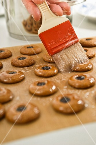 Gingerbread being brushed with a glaze