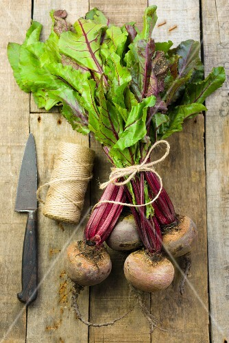 A bundle of beetroot on a wooden surface