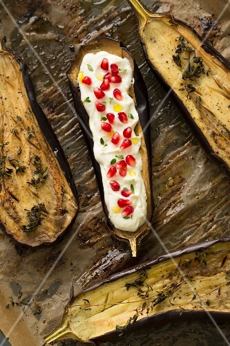 Oven-roasted aubergines with pomegranate yoghurt, thyme and olive oil