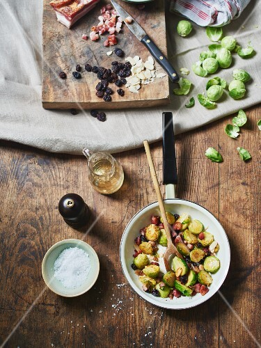 Fried Brussels sprouts with bacon, currants and almonds