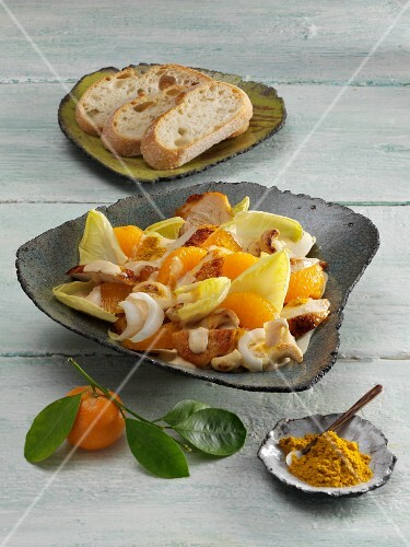 Chicken salad with chicory, mandarins and cashew nuts