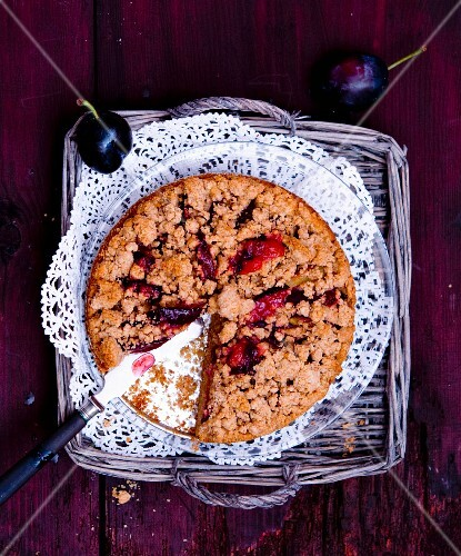 Wholemeal damson cake with crumbles, sliced