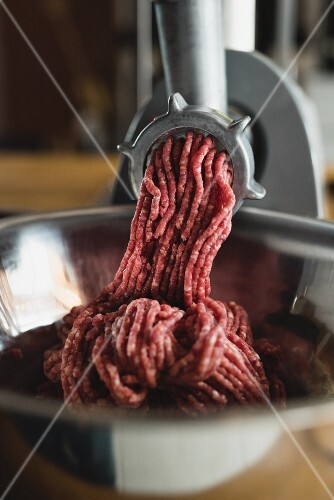 Meat coming out of a mincer
