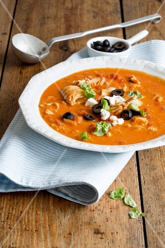 Fish fillet in tomato sauce with feta cheese and olives
