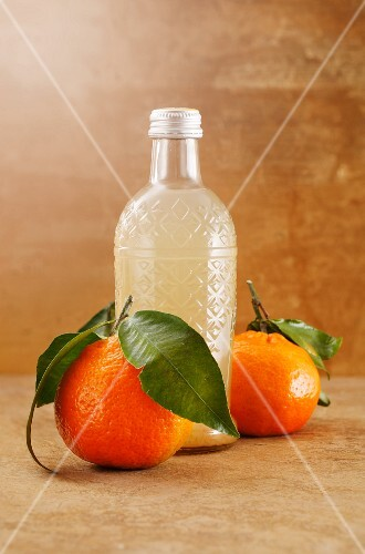 Homemade mandarin lemonade in a glass bottle