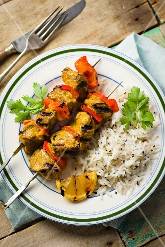 Spicy lamb kebabs with rice
