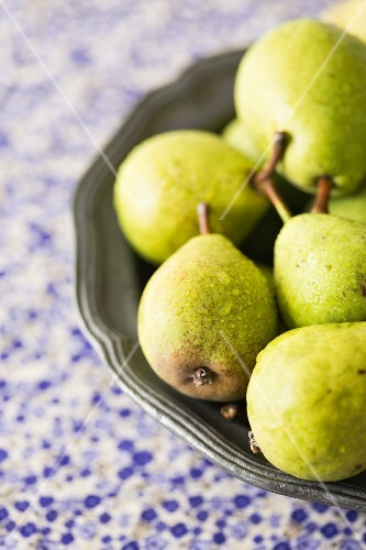 Fresh pears in a metal bowl