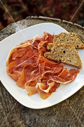 Country ham with bread on a plate
