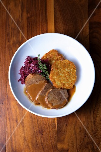 Beef Yankee pot roast with crispy potato fritters and braised red cabbage