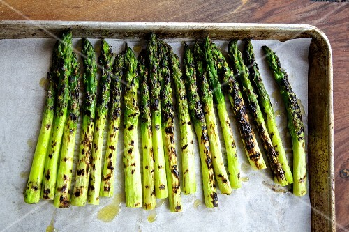 Roasted asparagus on parchment paper