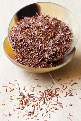 A bowl of rooibos tea leaves