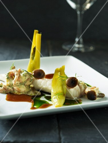 Cod fillet with a prawn salad, mushrooms and baby fennel