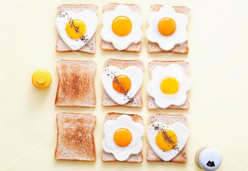 Slices of toast with fried eggs