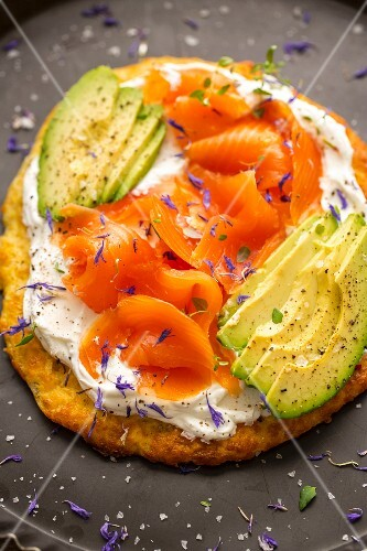 Coconut flour pizza with goat's cheese, avocado and smoked salmon
