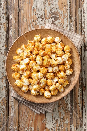 Popcorn on a wooden plate