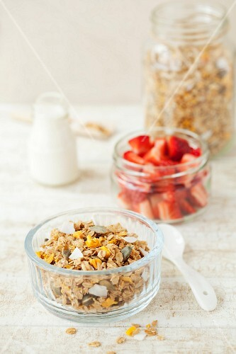 Homemade granola muesli with mango and coconut glass bowl