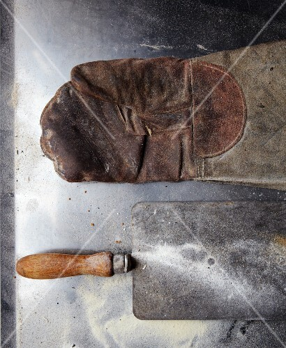 A glove and a baking paddle