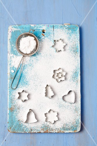 Christmas cutters and a sieve with icing sugar