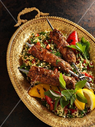 Oriental minced lamb skewers on a bed of tabbouleh