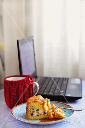 A slice of Cassata Siciliana next to a laptop