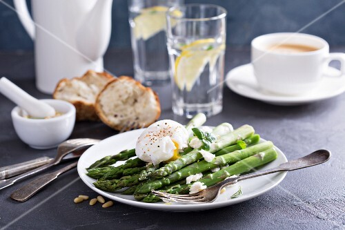 Poached asparagus with feta cheese, pine nuts and a poached egg